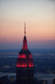 RT Empire State Bldg @EmpireStateBldg: With lights in all red, we're honoring the 125th anniversary ...