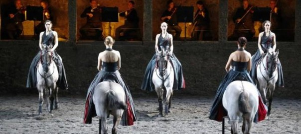 """Horses and riders perform on stage during a dress rehearsal of Wolfgang Amadeus Mozart's cantata """"Davide penitente"""" in Salzburg"""